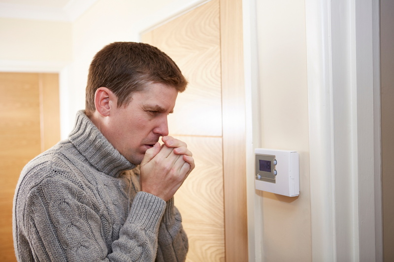 cold-man-with-thermostat