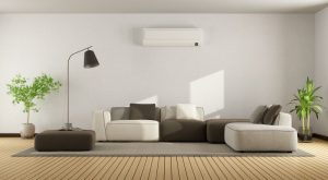 ductless-air-handler-up-on-wall-in-modern-looking-living-room