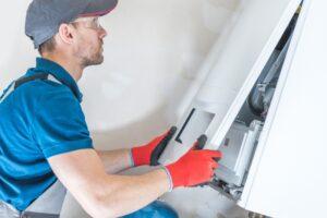 technician-working-on-furnace